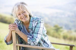 photo of senior woman sitting outdoors | LaserMed