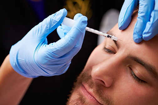 photo of a man having a Botox injection at a beauty clinic