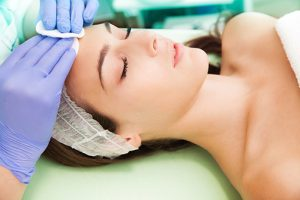 photo of woman getting a facial | LaserMed Skin and Vein Clinic