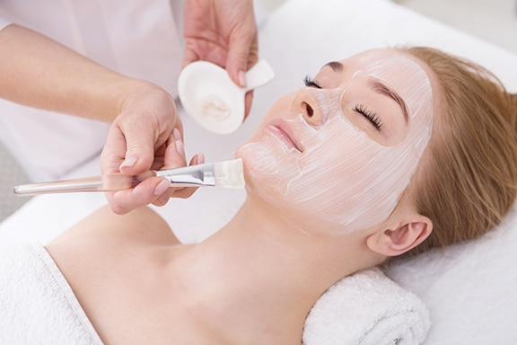 photo of young woman getting facial nourishing mask by beautician | Dr. Jean Chapman