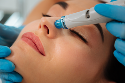 photo of woman getting a hydrafacial